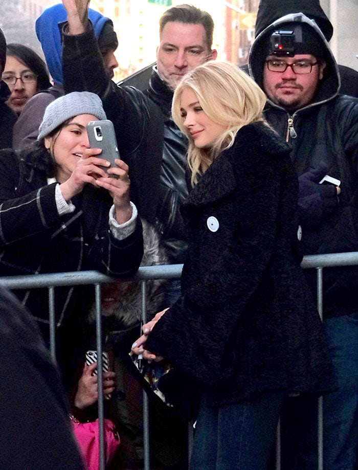 Chloe Grace Moretz takes a selfie with a fan while promoting her new movie in New York City