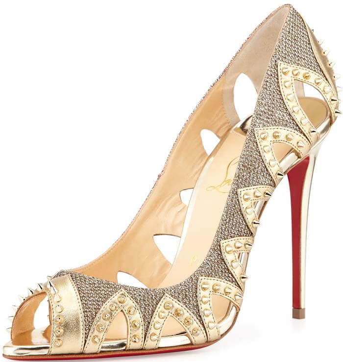 Christian Louboutin's Pinder City pump channels another era with its artful leather cutouts and textured goldtone finish