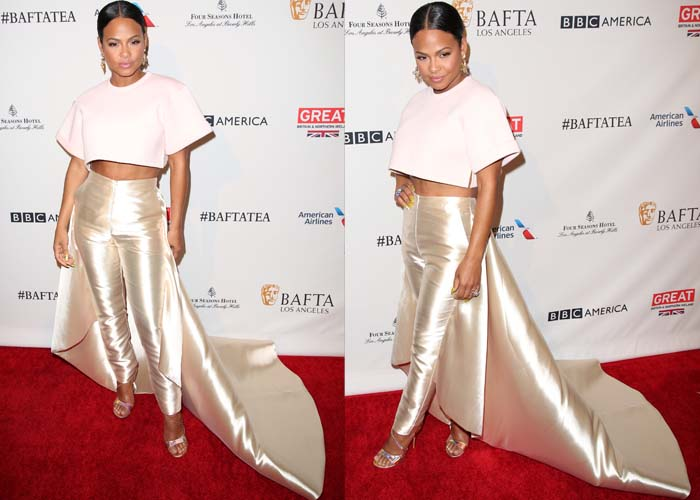 Christina Milian wears a Marc Jacobs crop top and metallic pants with an attached train