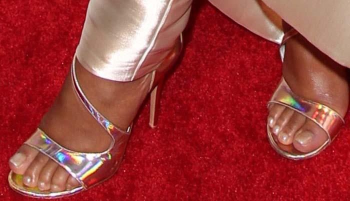 Christina Milian's feet in silver Stuart Weitzman sandals