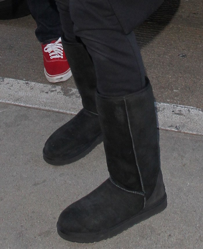 Ciara in wearing tall UGG boots with black pants