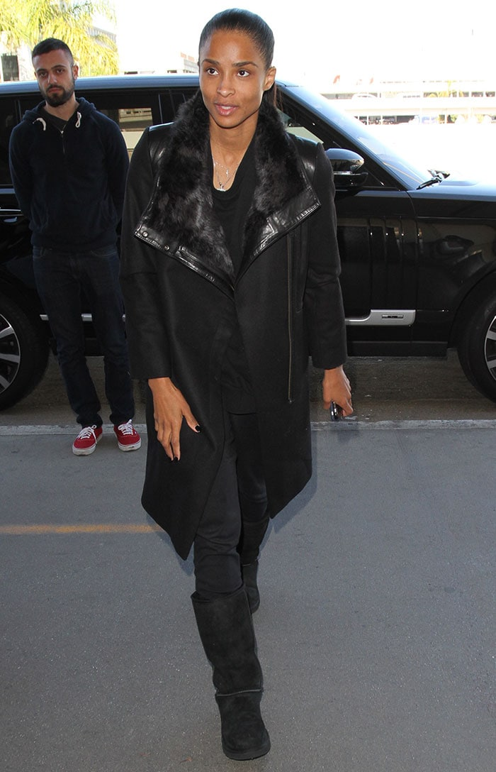 Ciara wore an all-black outfit comprised of a loose black top, a pair of black pants, a black coat and a pair of black Uggs