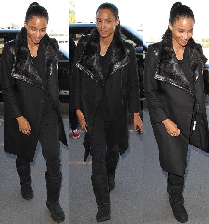 Ciara wearing a loose black top, a pair of black pants, a black coat and a pair of black Uggs