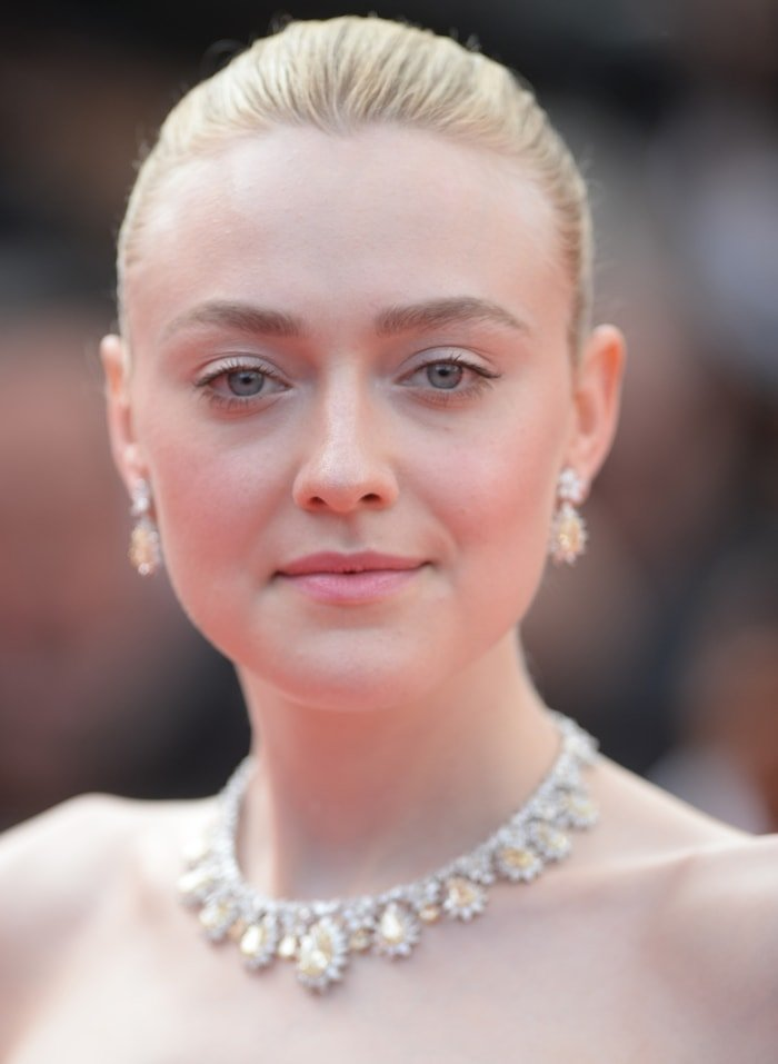 Dakota Fanning wears Chopard jewelry on the red carpet at the Once Upon A Time In Hollywood premiere