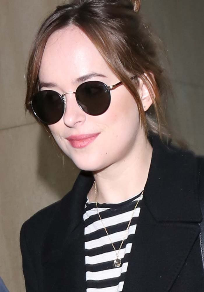 "Dakota Johnson accessorized with a pair of ""Wilson"" sunglasses from Garrett Leight"