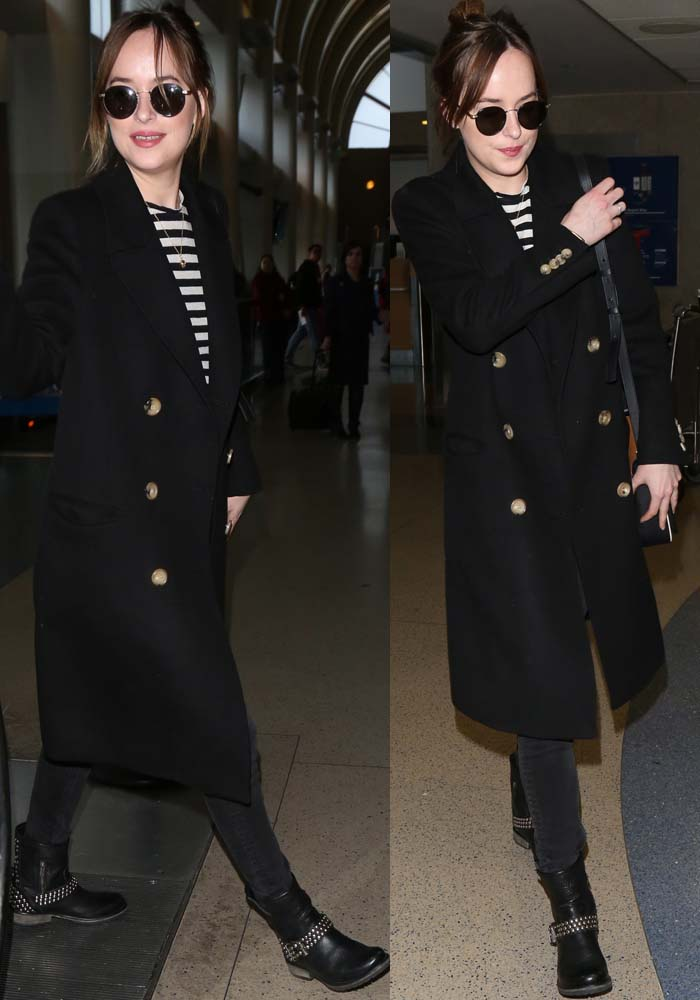 Dakota Johnson in a striped tee by Alexander Wang and a long Gucci coat