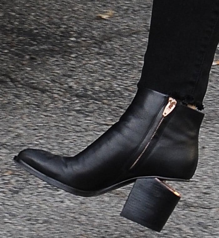Demi Lovato's feet in black leather Alexander Wang boots