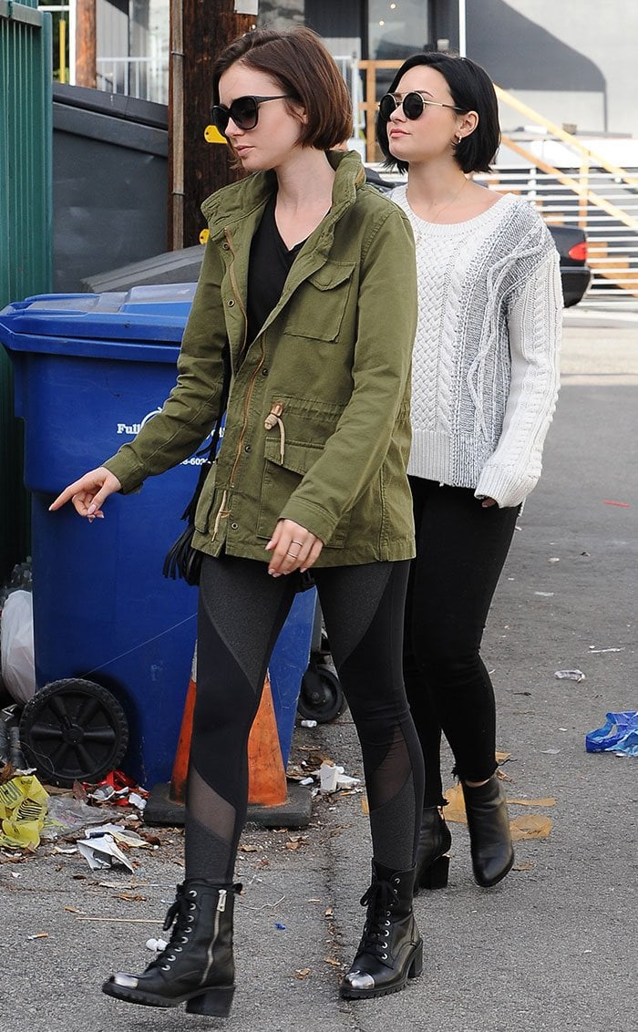 Lily Collins and Demi Lovato wear neutral colors and boots as they leave a lunch date in Los Angeles