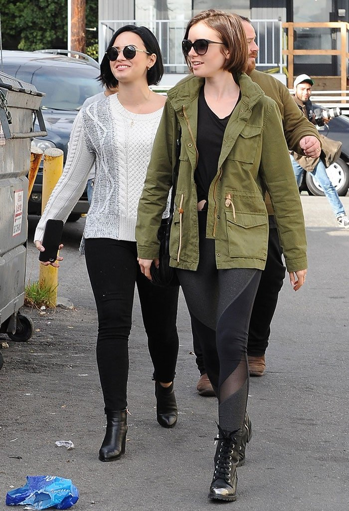 Lily Collins and Demi Lovato both wear their hair down as they leave lunch at La Conversation