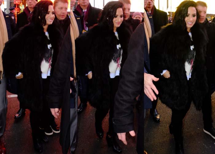Demi Lovato wears a black fur coat at New York City's Times Square