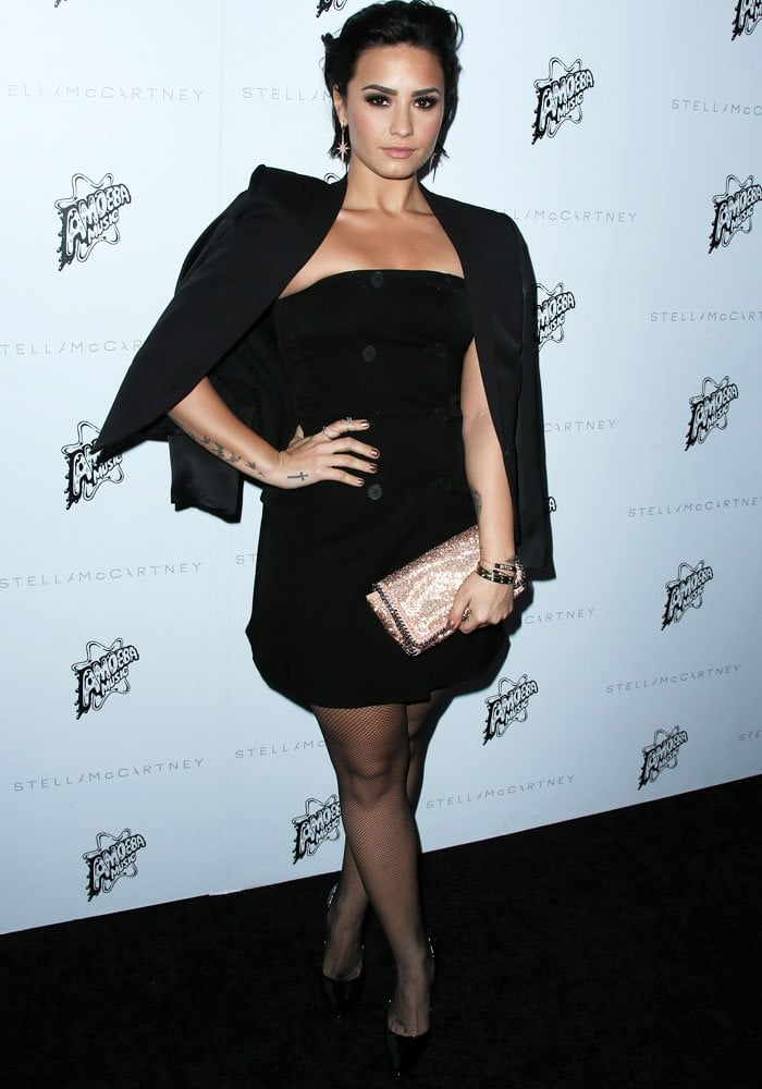Demi Lovato stuck to her all-black look in a dress and blazer combination by Stella McCartney