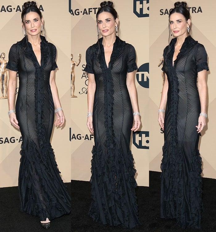 Demi-Moore-fitted-black-sheer-dress-ruffled-hem