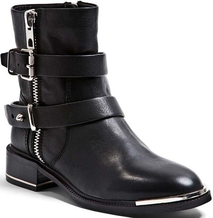 Hits of metal complement the edgy look of these Dolce Vita moto booties