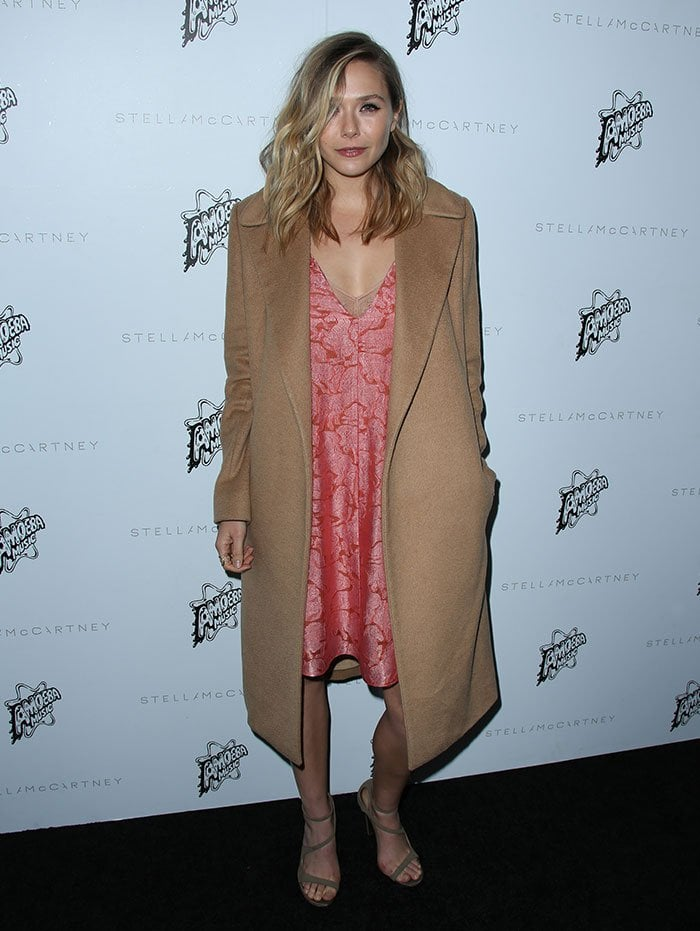 Elizabeth Olsen wears her hair down at the Stella McCartney Autumn 2016 Collection Event