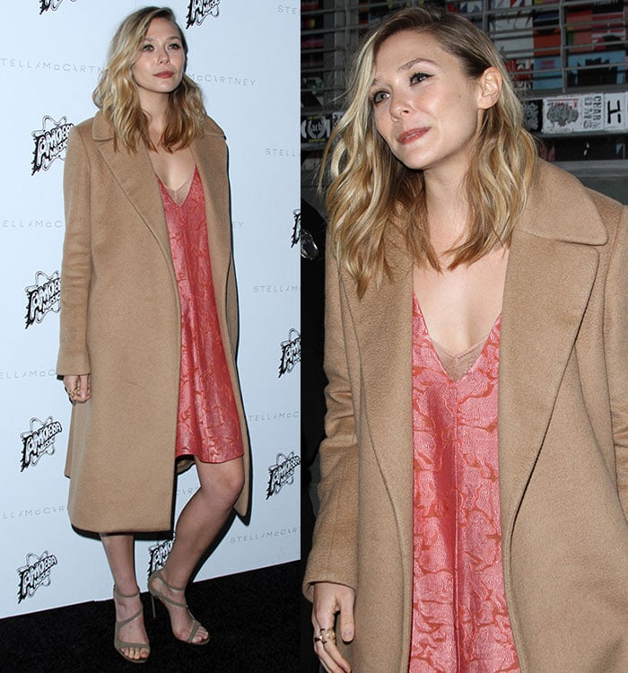 Elizabeth Olsen covers her pink embroidered dress with a long tan coat