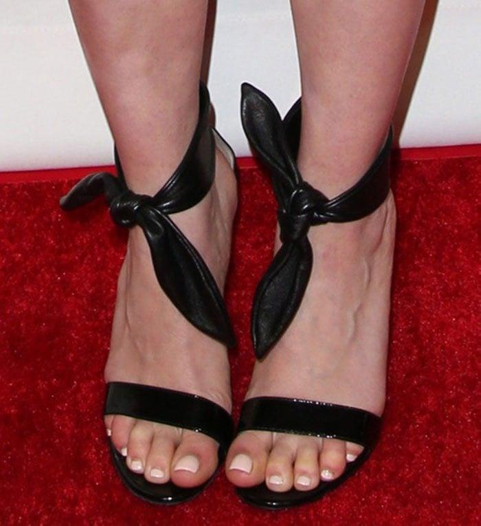 Emilia Clarke shows off her sexy feet in Gianvito Rossi sandals