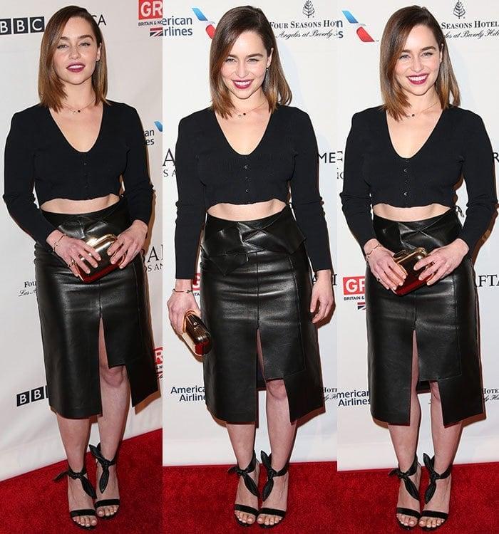 Emilia Clarke shows off her fabulous legs inblack leather sandals