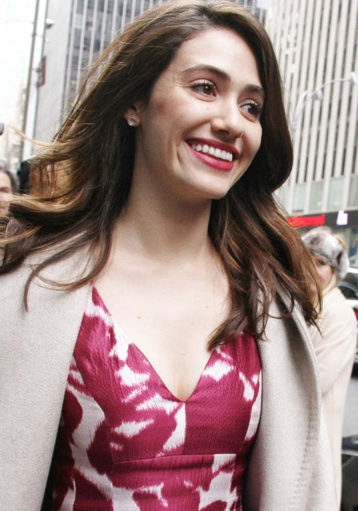 Emmy Rossum wears her hair down as she visits SiriusXM's offices