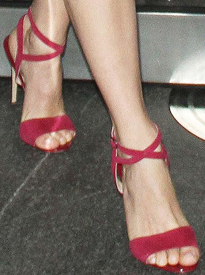 Emmy Rossum's feet in rose-colored Paul Andrew heels