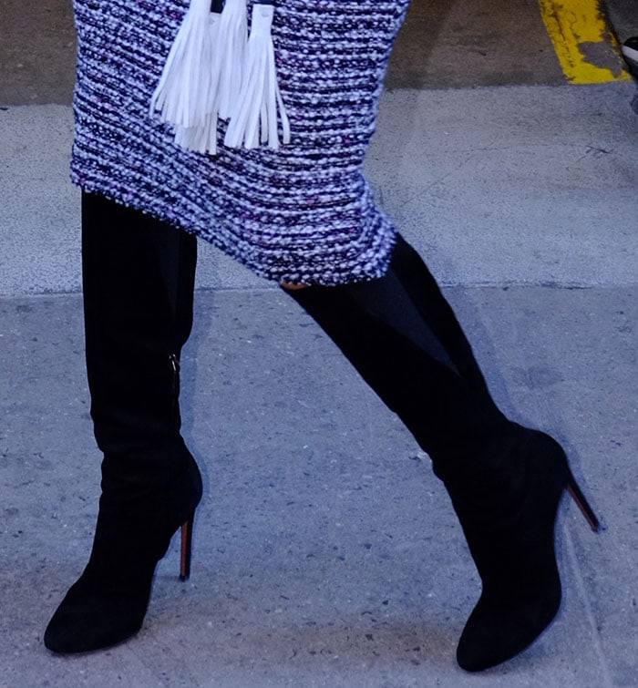 Eva Longoria in black suede knee-high boots