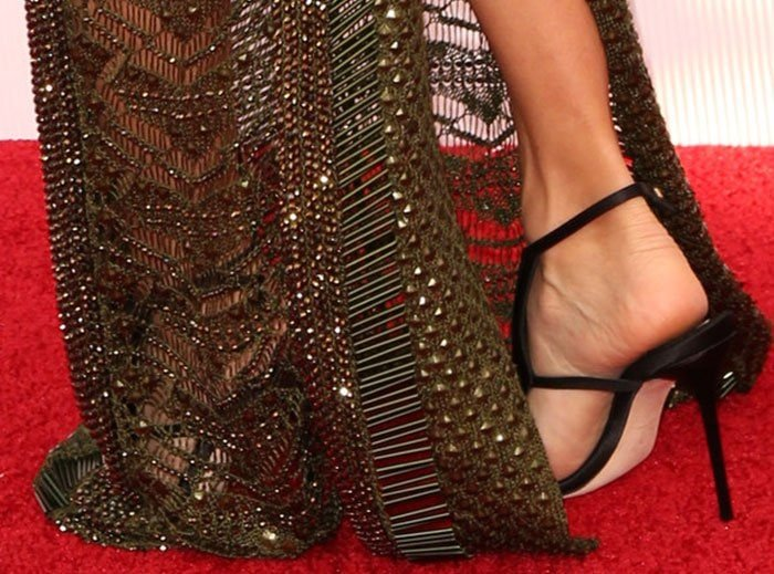 Eva Longoria's feet in black satin Olgana sandals