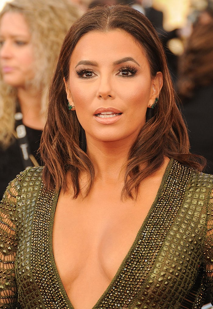 Eva Longoria center parts her hair for the 22nd Annual Screen Actors Guild Awards