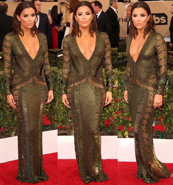 Eva Longoria shows off her cleavage in an olive green Julien Macdonald gown