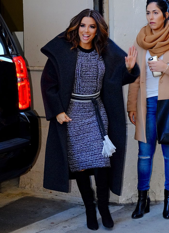 Eva Longoria wears her hair in curls as she arrives at Huffington Post