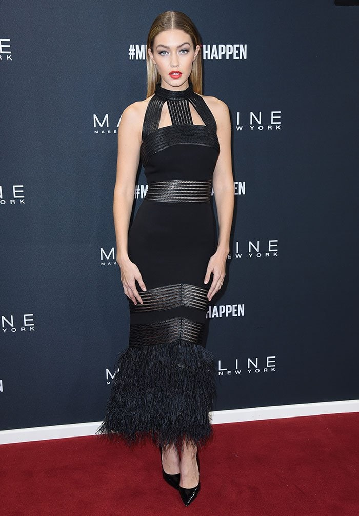 Gigi Hadid shows off her model body on the red carpet in a Sally LaPointe pre-fall 2016 dress