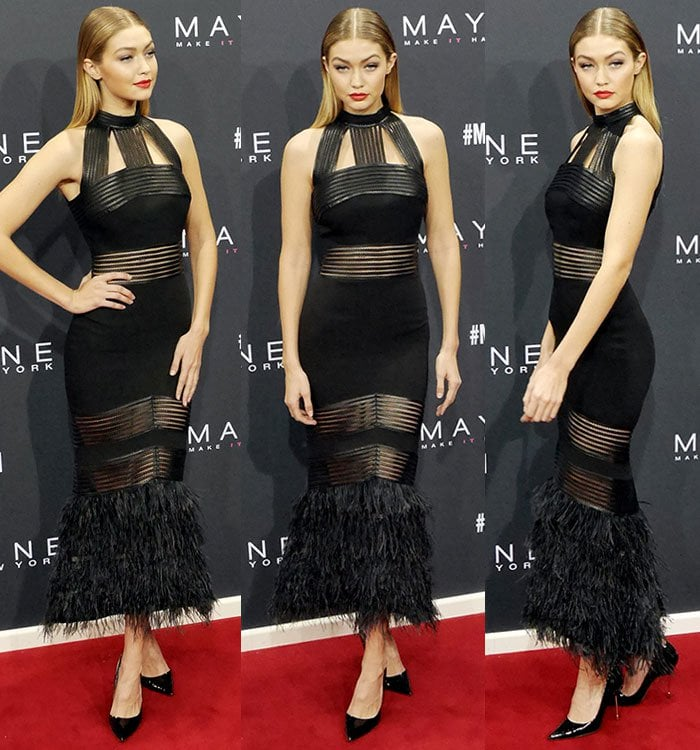 Gigi Hadid wears an all-black look complete with a leather-and-feather dress on the red carpet