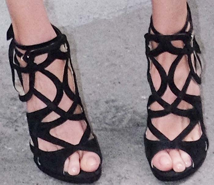 Heather Graham's feet in black cage sandals