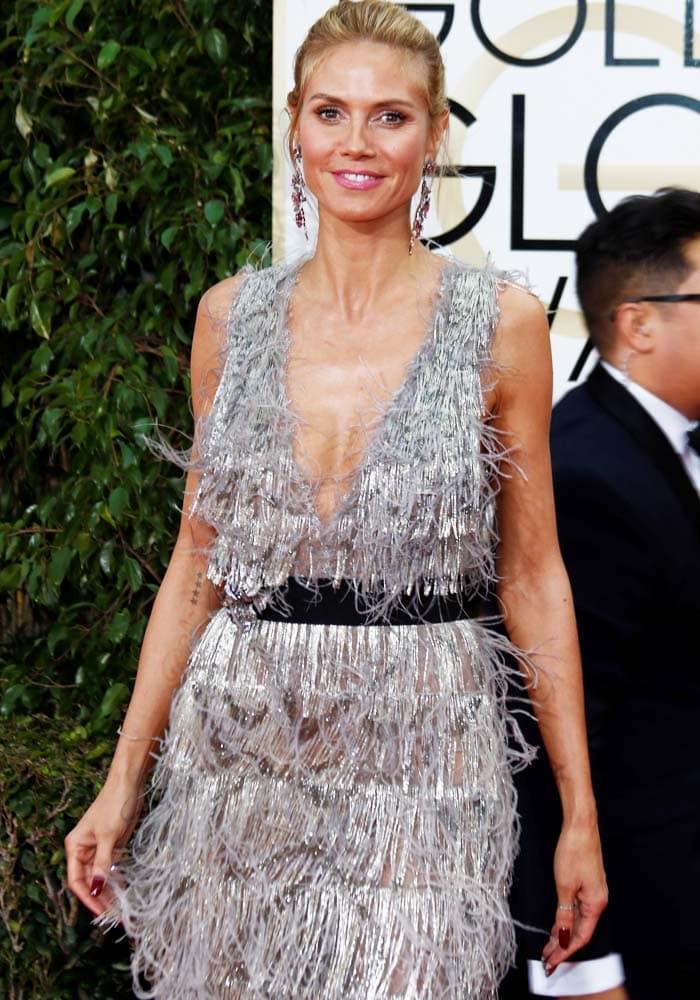 Heidi Klum sparkles in a flapper-style silver Marchesa dress