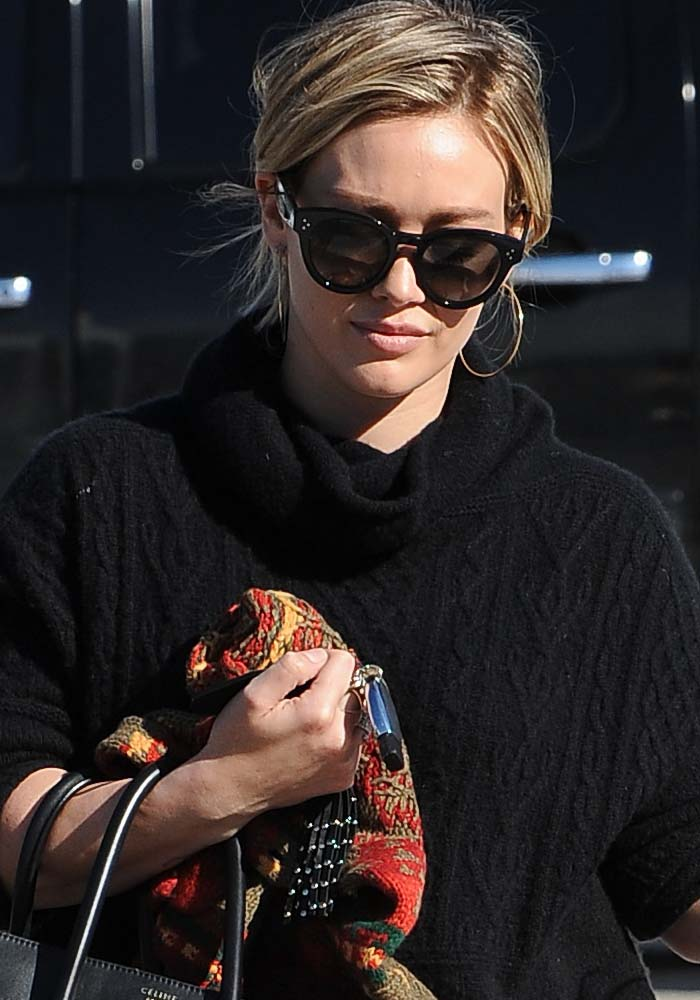 Hilary Duff wears her hair back during an outing with her son Luca Comrie