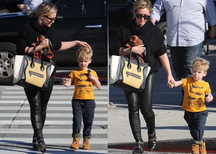 Hilary Duff holds a Céline bag in one hand and her son Luca in the other