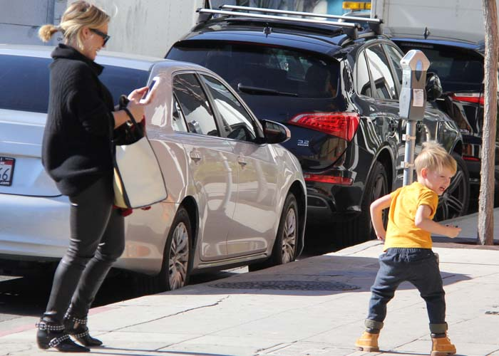 Hilary Duff takes a photo of her son Luca while the two have a play date
