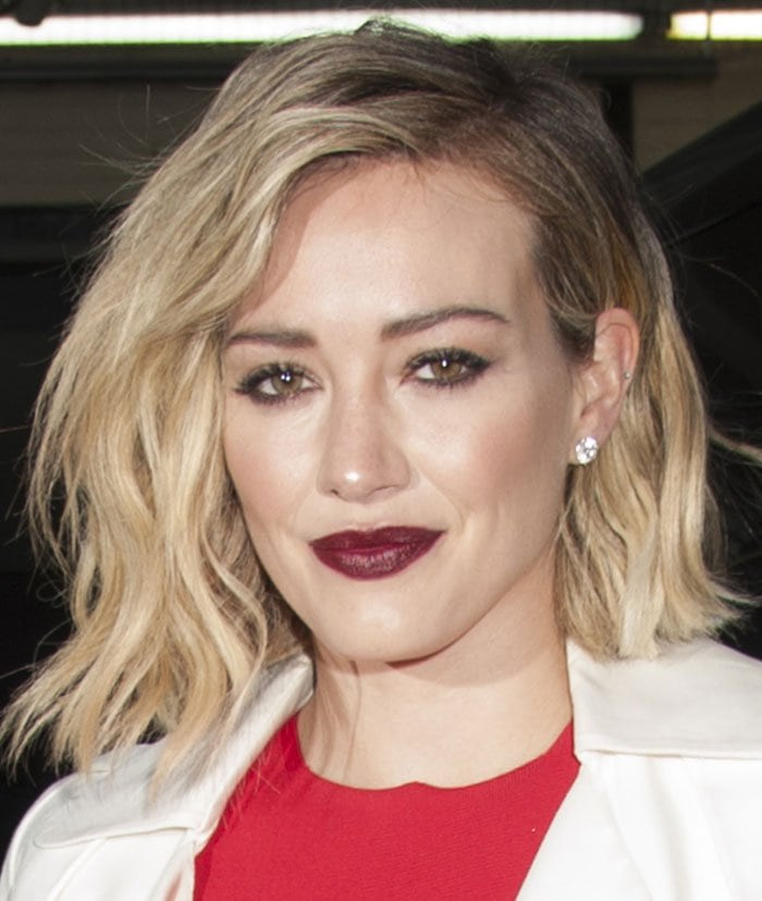 Hilary Duff wears her blonde hair down as she arrives at AOL Build in New York City