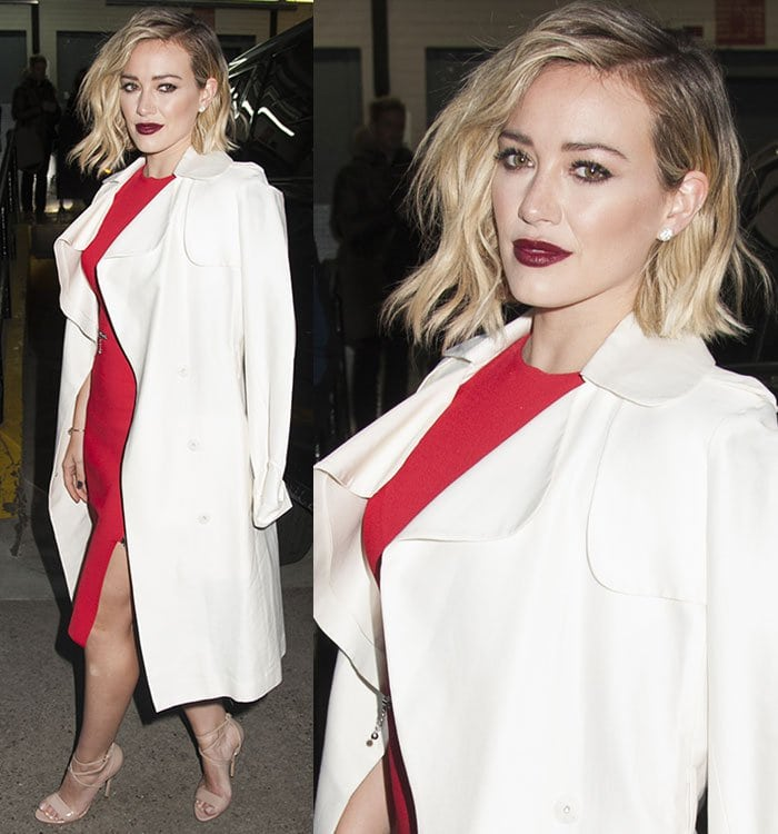 Hilary Duff finishes her AOL Build ensemble with a white trench coat from Camilla and Marc