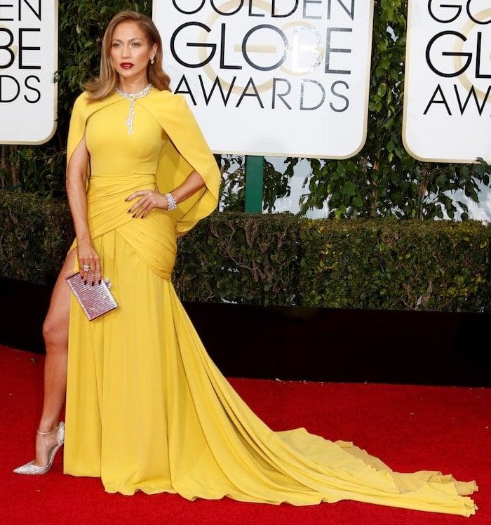 Jennifer Lopez shows off the train on her yellow Giambattista Valli dress