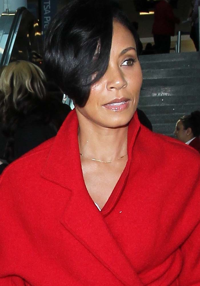 Jada Pinkett-Smith wears her hair down as she arrives at Los Angeles International Airport