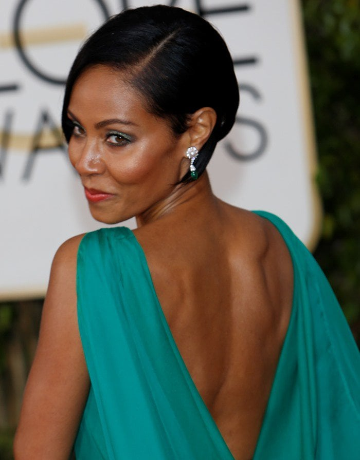 Jada Pinkett Smith shows off her toned back in an emerald green chiffon gown from Atelier Versace