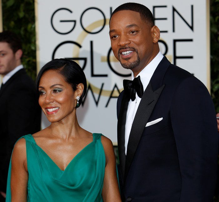 Jada Pinkett Smith and Will Smith pose for photos together on the red carpet of the Golden Globe Awards