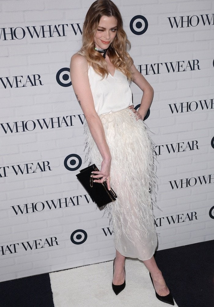 Jaime King poses on the black-and-white carpet in a Steven Kahlil feather skirt and a silk white top