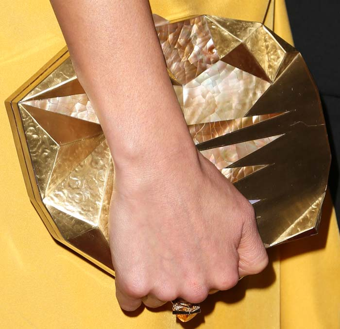 Jamie Chung carries an interesting geometric clutch from Emm Kuo