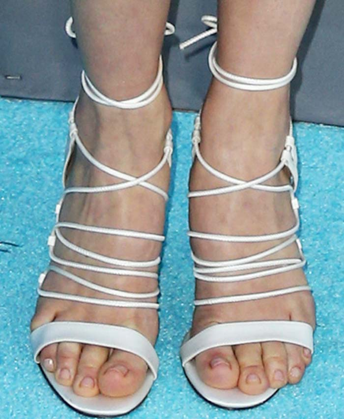 January Jones's feet in strappy Bionda Castana sandals