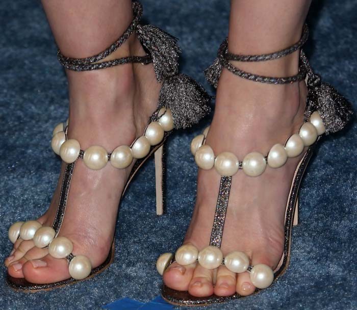 January Jones's feet in oversized pearl-and-glitter sandals by Paula Cademartori
