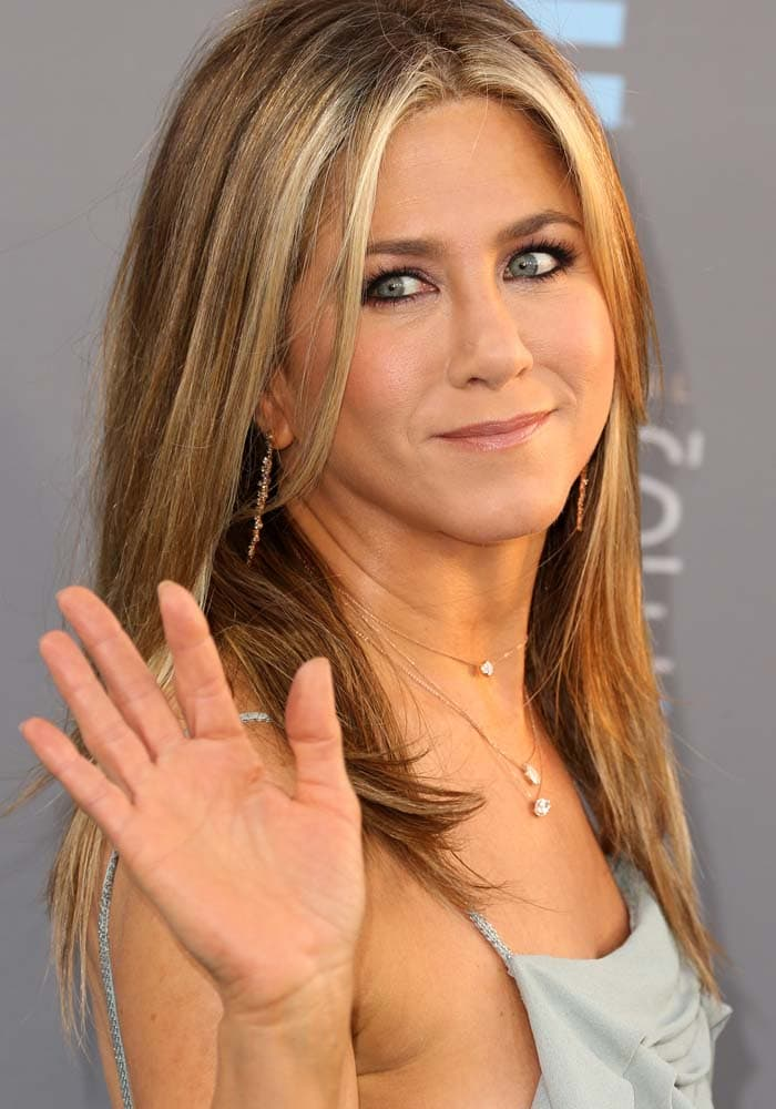 Jennifer Aniston accessorized with jewelry from Anita Ko, Suzanne Kalan, and Carbon and Hyde