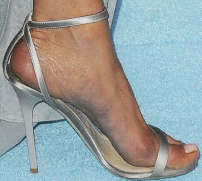 Jennifer Aniston shows off her feet in classic satin ankle-strap Minny sandal from Jimmy Choo
