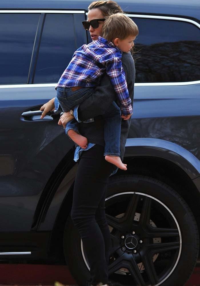 Jennifer Garner carries her son Samuel to the car after a playdate