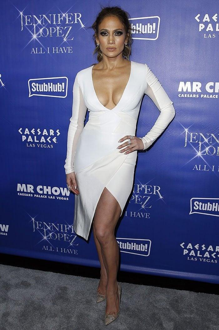 Jennifer Lopez flaunts her legs in a skintightGabriela Cadena dress