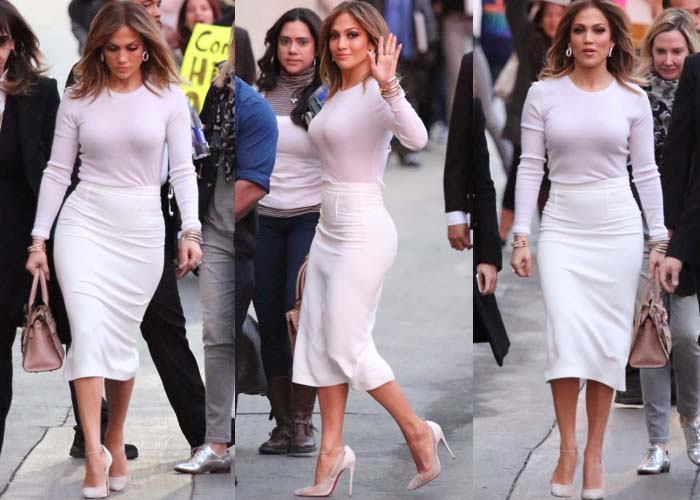 Jennifer Lopez wears a long-sleeved white shirt paired with a Roland Mouret skirt